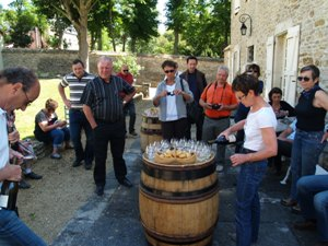 Wine tasting in the courtyard Domaine Chapelle, Santenay, Burgundy