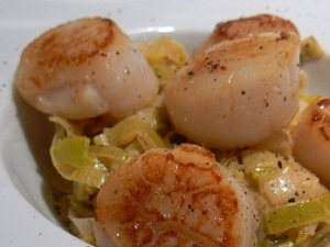 St Jacques scallops on a bed of leak purée