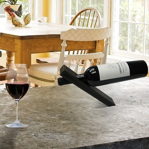 The magic leather wine holder seen on Comment Se Ruiner